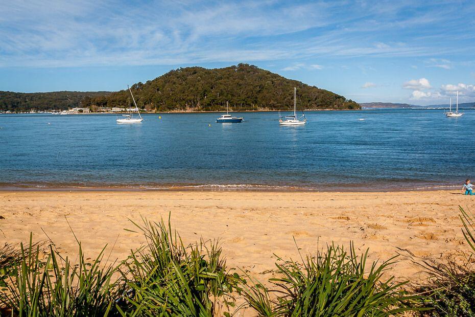 Ettalong Beach, boats moored, green hill