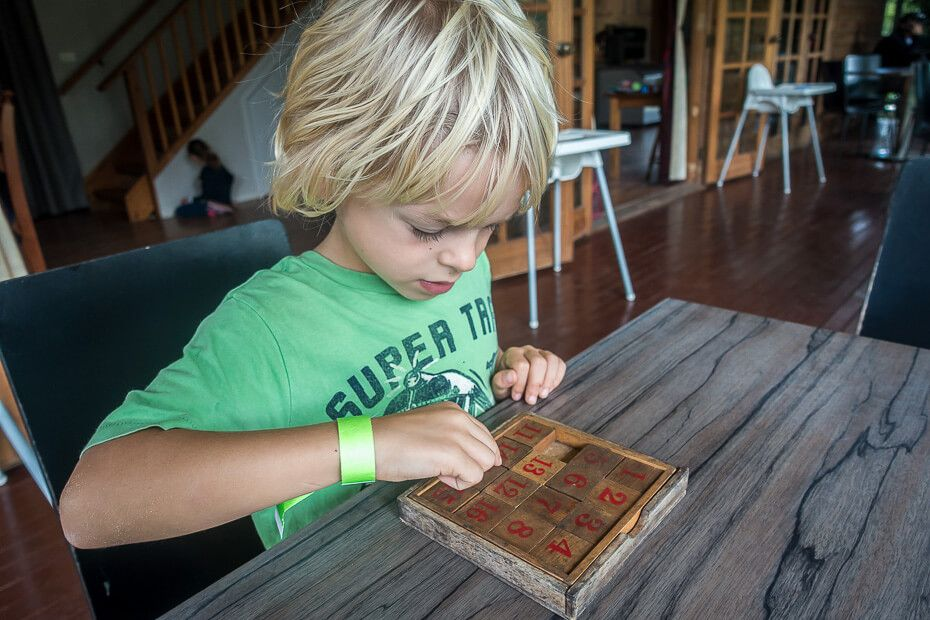 Playing with wooden games at the cafe