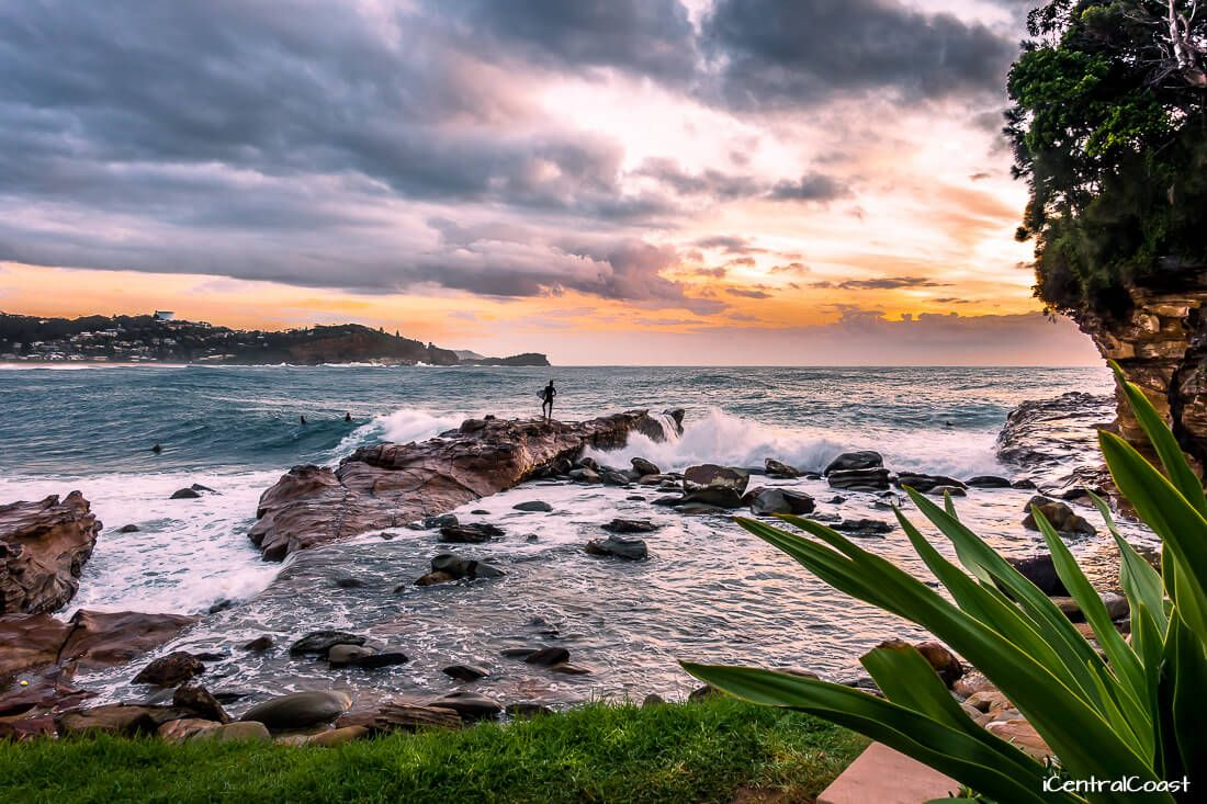 Surfing at Avoca Point at sunrise