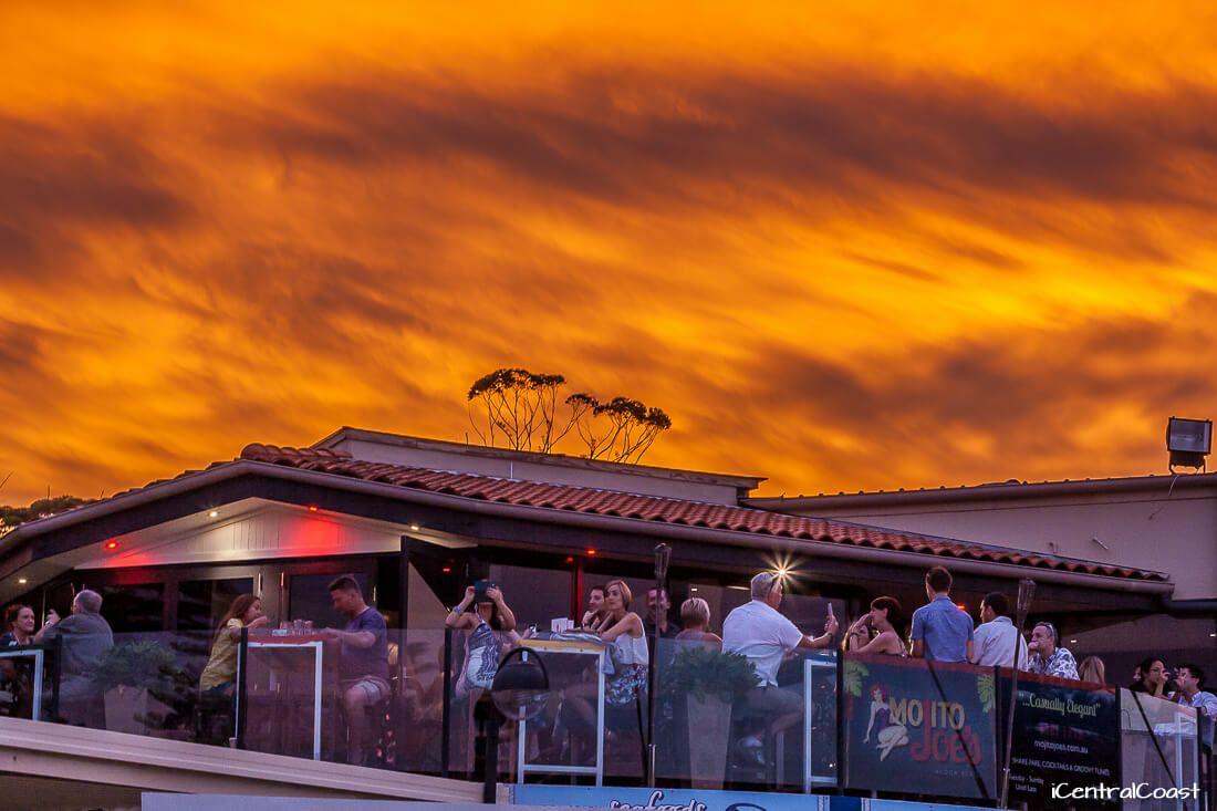 Drinking cocktails at Mojito Joe's at sunset