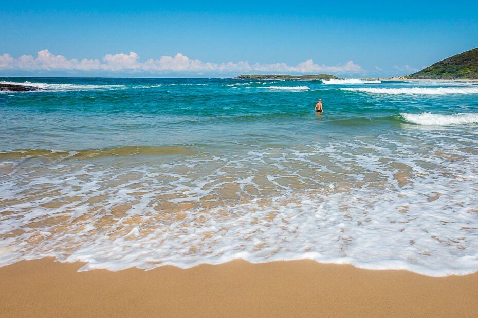 Having a dip at Moonee Beach