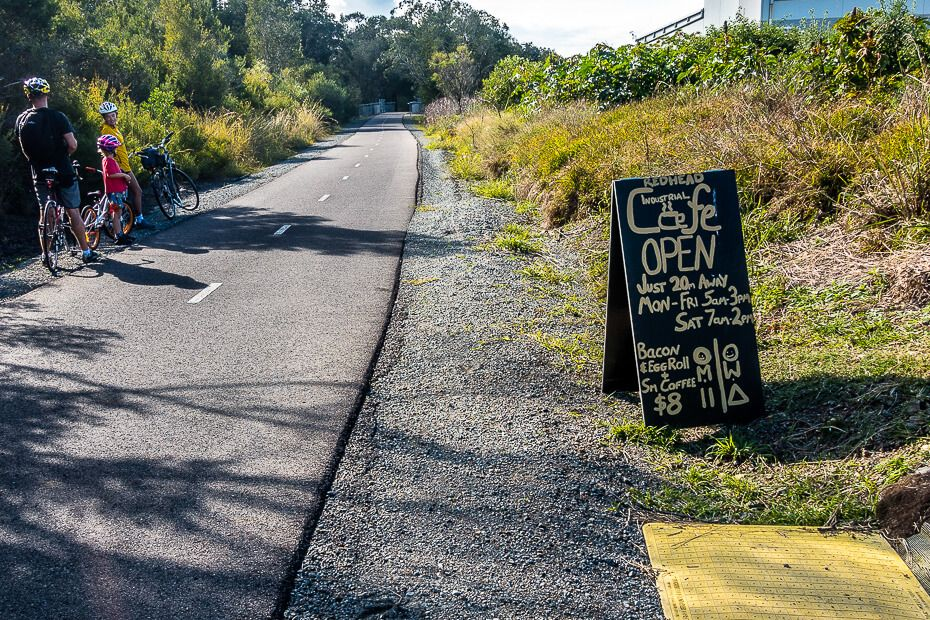 Sign for cafe on the side of the cycleway