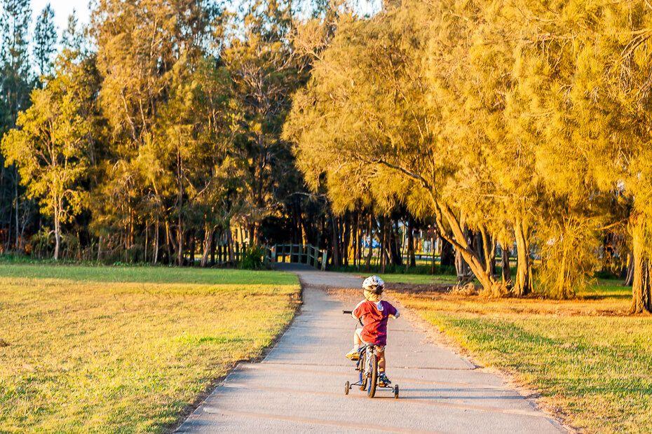 boy cycling the Tuggerah Lake Cycleway