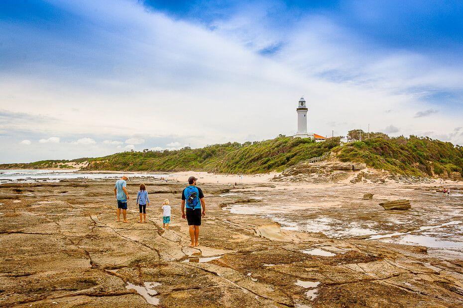 Walking on the rock platform below the lighthouse.