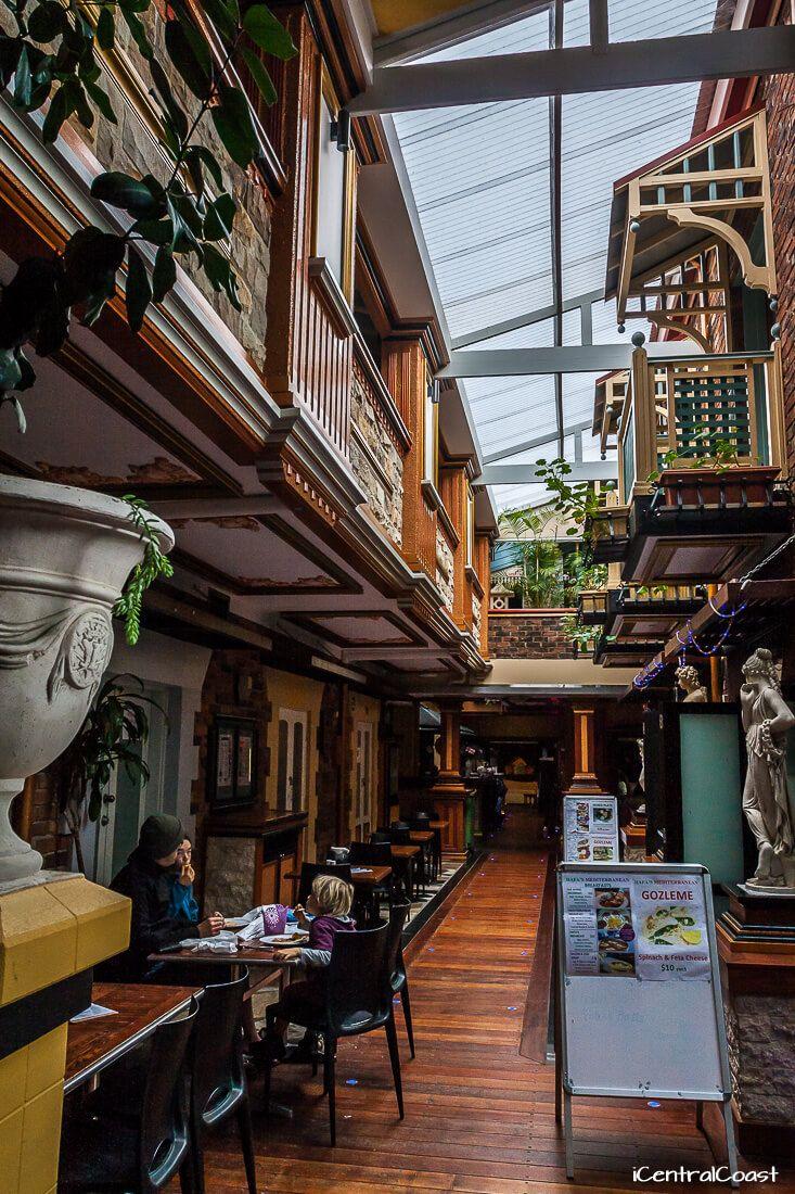 Mediterranean decor at the markets: stone, wood, brick, terracotta & mustard colours, statues, pot plants, indoor balconies.