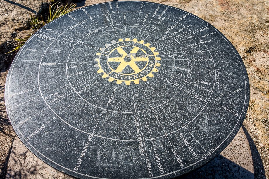 Round stone table that shows where places are located.